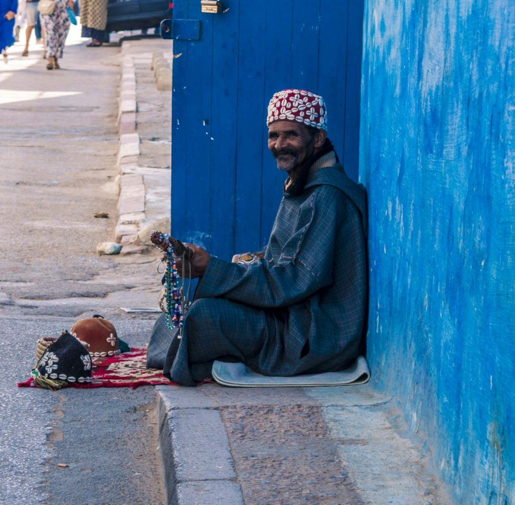 by Marwa guembri in Oudaya Rabat, a busker was playing the guembri and as I leaned in to take a picture he stopped and smiled (asked for money later, but the way he played, he deserved it )