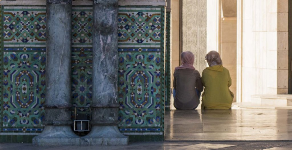 two women chatting away the evening on the steps on Hassan 2 mosque